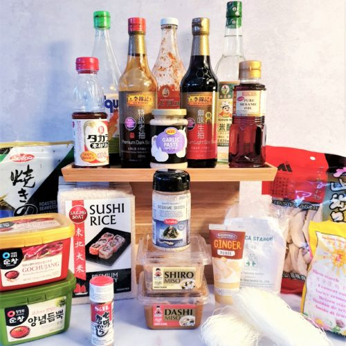 Front on shot of all Asian Ingredients discussed in post. Bottle are raised higher in the background with the other ingredients surrounding them in from.